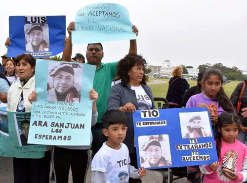 Relatives of Luis Carlos Nolasco, one of the 44 crew members of the missing at sea ARA San Juan submarine, hold portraits of him during a demonstration at an Argentine naval base (Image: REUTERS)