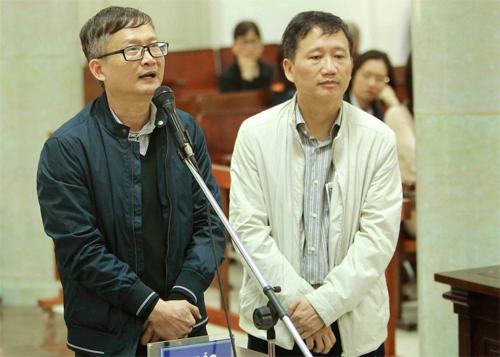 Ông Trịnh Xuân Thanh và Đinh Mạnh Thắng trong cuộc đối chất tại tòa ngày 24/1.Ảnh: TTXVN.