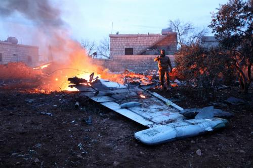 Mảnh vỡ Su-25 Nga rơi ở Syria. Ảnh: AFP.