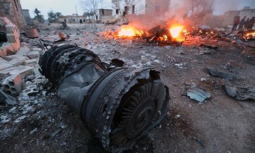 Mảnh vỡ máy bay Su-25 Nga ở Syria. Ảnh: AFP.