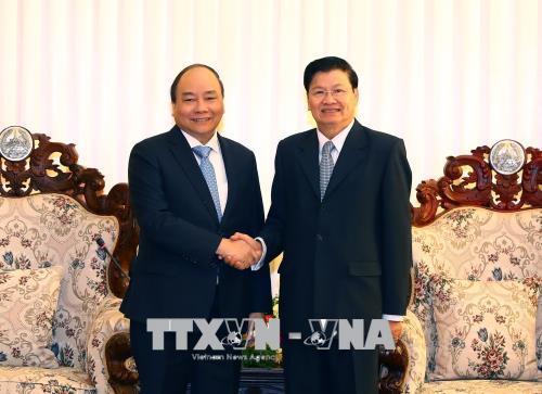 Thủ tướng Nguyễn Xuân Phúc và Thủ tướng nước CHDCND Lào Thongloun Sisoulith đồng chủ trì Kỳ họp lần thứ 40 Ủy ban liên Chính phủ Việt Nam  Lào