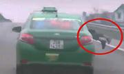 Bắt tài xế taxi chạy 20km khi cảnh sát nằm trên capo