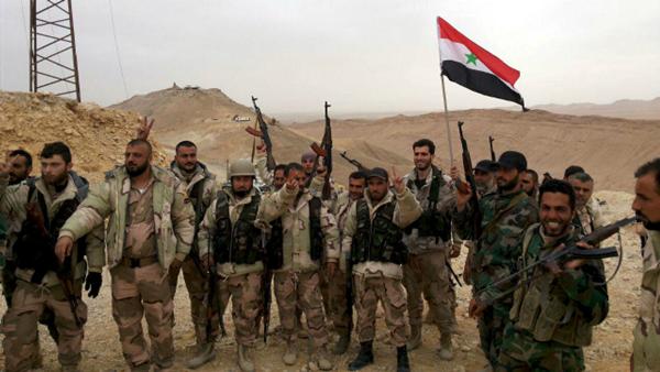 Các tay súng ủng hộ chính phủ Syria. Ảnh: Reuters.