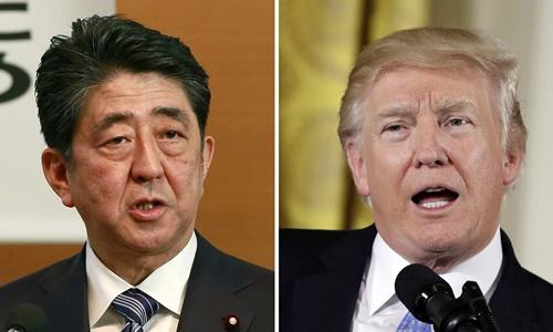 Thủ tướng Nhật Bản Shinzo Abe (trái) và Tổng thống Mỹ Donald Trump. Ảnh: AP.