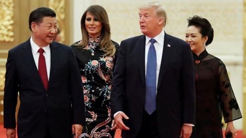 Vợ chồng Tổng thống Mỹ Trump tháng 11 năm ngoái gặp vợ chồng Chủ tịch Trung Quốc Tập Cận Bình ở Bắc Kinh. Ảnh: Reuters.