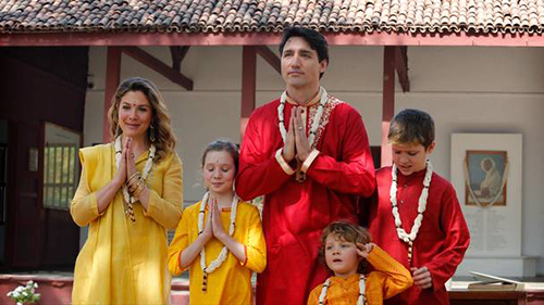 Canadian Prime Minister Justin Trudeau (L), his wife Sophie Gregoire Trudeau (2R), their children Ella-Grace (2L), Xavier (C), Hadrien (3L) and Elabehn Bhatt, Chairperson of Sabarmati Gandhi Ashram Preservation and Memorial Trust (R) visit Gandhi Ashram in Ahmedabad on February 19, 2018.