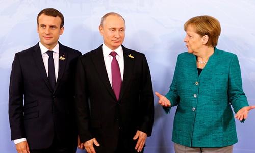 Từ trái qua, Tổng thống Pháp Emmanuel Macron, Tổng thống Nga Vladimir Putin và Thủ tướng Đức Angela Merkel. Ảnh: Reuters.