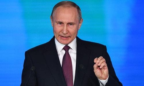 Tổng thống Nga Vladimir Putin đọc thông điệp liên bang hôm 1/3. Ảnh: AFP.