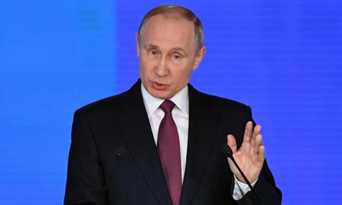 Tổng thống Nga Putin đọc thông điệp liên bang hôm 1/3. Ảnh: Reuters.