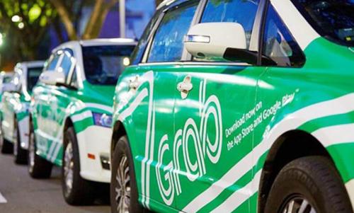 Xe Grab, Uber có thểphải gắn phù hiệu Taxi. Ảnh minh họa: Anh Tú.