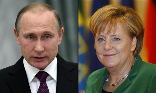 Tổng thống Nga Vladimir Putin (trái) và Thủ tướng Đức Angela Merkel. Ảnh: Reuters.