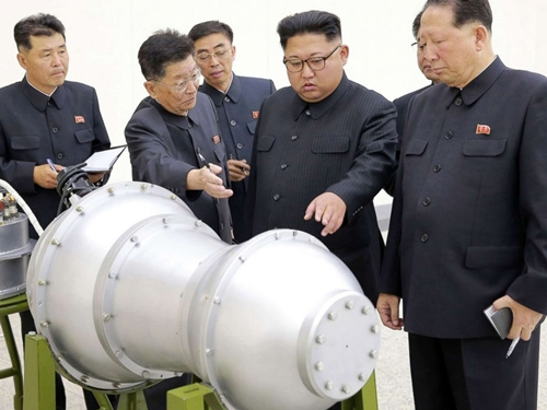 This undated picture released by North Koreas official Korean Central News Agency (KCNA) on Sept. 3, 2017 shows North Korean leader Kim Jong-Un, center, looking at a metal casing with two bulges at an undisclosed location.