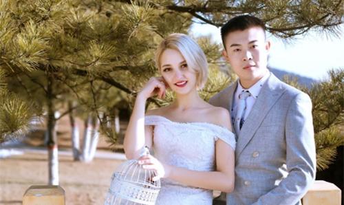 Ảnh cưới của He và Inesa. Ảnh:163.com