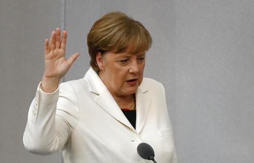 Bà Angela Merkel tuyên thệ nhậm chức thủ tướng Đức ngày 14/3. Ảnh: Reuters.