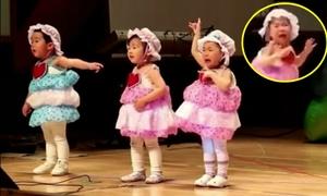 Bé gái dù khóc như mưa nhưng vẫn kiên cường nhảy múa
