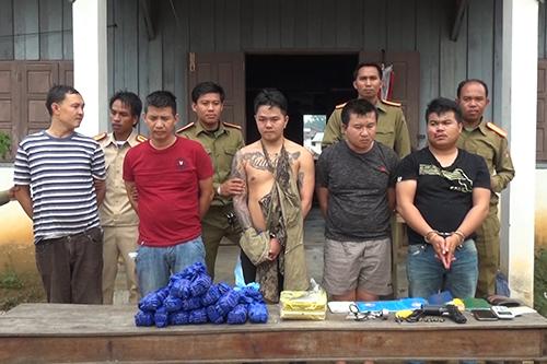 Đây là năm người trong đường dây chuyển ma tuý xuyên quốc gia từ Thái Lan, sang Lào và Việt Nam. Ảnh:Mạnh Hùng