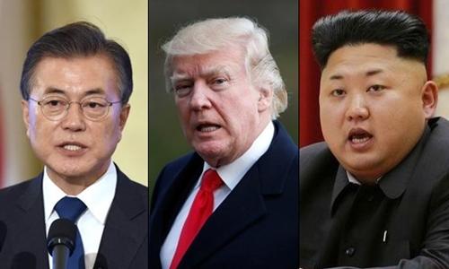 Từ trái sang, Tổng thống Hàn Quốc Moon Jae-in, Tổng thống Mỹ Donald Trump và nhà lãnh đạo Triều Tiên Kim Jong-un. Ảnh: Reuters.