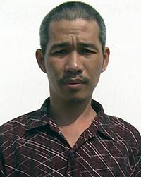 Phạm Trung Sẻ bị bắt giữ khi rượt chém lực lượng công an làm nhiệm vụ. Ảnh: Lan Vy