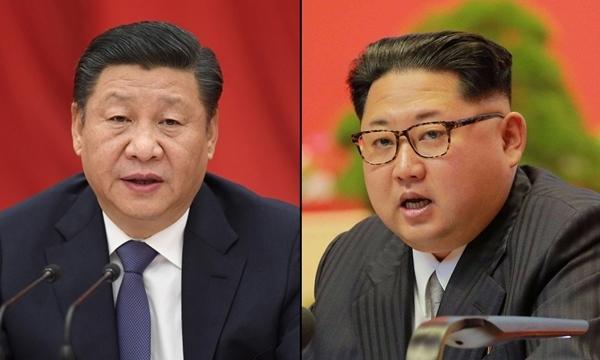Chủ tịch Trung Quốc Tập Cận Bình (trái) và nhà lãnh đạo Triều Tiên Kim Jong-un. Ảnh: China Daily/Reuters.