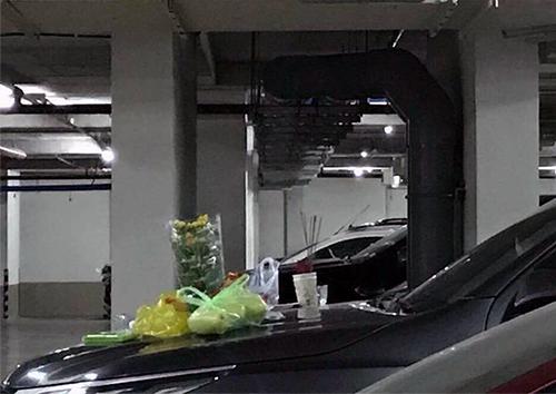 Thắp nhang cúng ôtô trong tầng hầm chung cư. Ảnh: Cộng đồng cư dân Masteri
