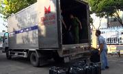 Ôtô tải giấu 18.000 gói thuốc lá lậu trong 'khoang bí mật'