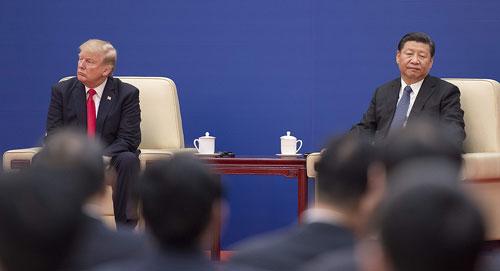 Tổng thống Mỹ Donald Trump (trái) và Chủ tịch Trung Quốc Tập Cận Bình trong cuộc gặp năm 2017. Ảnh: AFP.