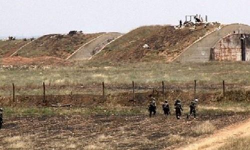 Binh sĩ chính phủ Syria tại căn cứ không quân Dabaa ở Homs. Ảnh: AP.