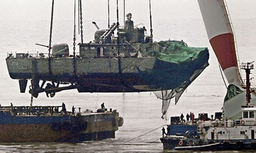 A giant floating crane lifts the stern of the South Korean warship Cheonan. Photograph: HONG JIN-HWAN/AFP/Getty Images