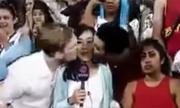 Nữ phóng viên Hong Kong bị nam khán giả hôn má trên truyền hình