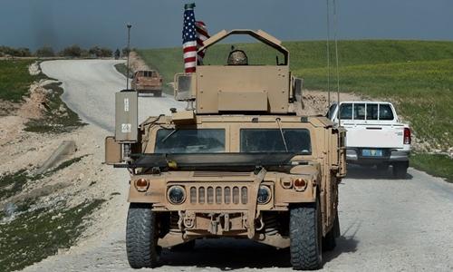 Xe của lực lượng Mỹ tại Syria hồi tháng ba. Ảnh:AP.