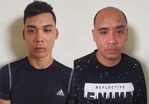 Nguyễn Văn Thảo (trái) và Nguyễn Khánh Hưng bị bắt giữ.