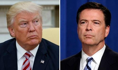 Tổng thống Mỹ Donald Trump và cựu giám đốc FBI James Comey. Ảnh: AP.