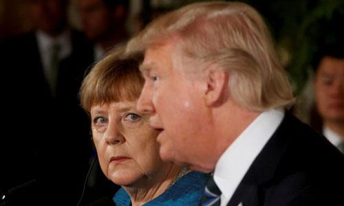 Thủ tướng Đức Angela Merkel (trái) và Tổng thống Mỹ Donald Trump. Ảnh: Reuters.