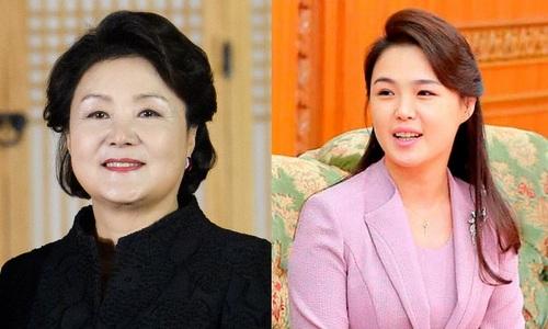 Bà Kim Jung-sook (trái) và bà Ri Sol-ju. Ảnh: CNN.