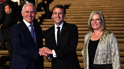 President of France Emmanuel Macron (centre) meets with Australias Prime Minister Malcolm Turnbull and his wife Lucy Turnbull at the Sydney Opera House.