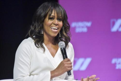 Bà Obama phát biểu tại hội nghị thượng đỉnh về phụ nữ. Ảnh: AFP.