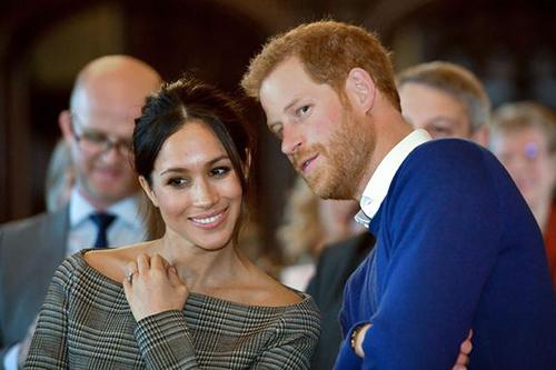 Hoàng tử Harry và hôn thê Meghan tại một sự kiện hồi tháng một. Ảnh: AP