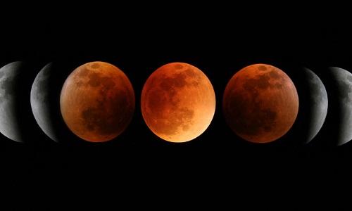 Mặt Trăng chuyển màu đỏ trong suốt nguyệt thực toàn phần. Ảnh: Phillip Holmes.