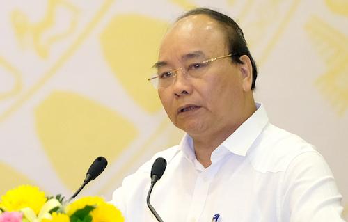 Thủ tướng Nguyễn Xuân Phúc phát biểu tại hội nghị sáng 19/5. Ảnh: VGP