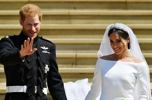 Hoàng tử Harry và vợ Meghan Markle trong hôn lễ ngày 19/5. Ảnh: AFP