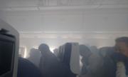 Hành khách sơ tán khỏi máy bay mù khói ở Tokyo