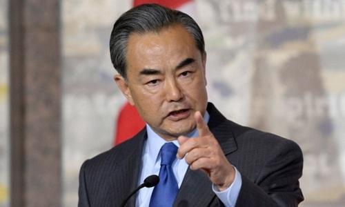 Ngoại trưởng Trung Quốc Vương Nghị cho rằng việc Mỹ rút lời mời tập trận là tư duy tiêu cực. Ảnh: CBC.