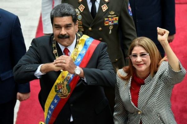 Venezuelan President Nicolas Maduro and his wife Cilia Flores arrive for his inauguration ceremony before the country's Constituent Assembly, which he set up himself last year and stacked with his supporters