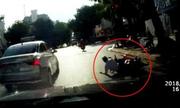 Cô gái bị tông ngã vì dừng xe máy tránh nắng cách cột đèn đỏ 20m