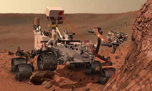 Robot Cusiosity khoan xuống bề mặt sao Hỏa để lấy mẫu vật hôm 20/5. Ảnh minh họa: Cover Image.