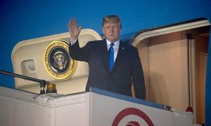 Khoảnh khắc Trump và Kim đặt chân đến Singapore