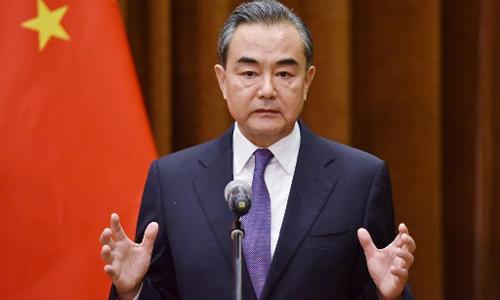Ngoại trưởng Trung Quốc Vương Nghị nhận xét về hội nghị Trump - Kim trong cuộc họp với Tổng thư ký ASEAN tại trụ sở Bộ Ngoại giao Trung Quốc ở Bắc Kinh hôm nay. Ảnh: AFP.