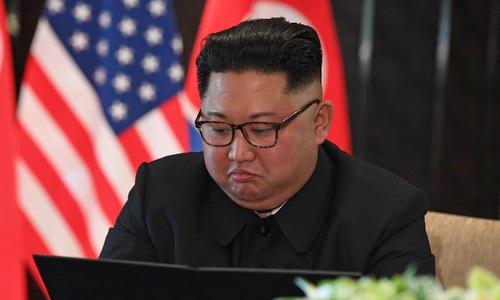 Lãnh đạo Triều Tiên trong lễ ký kết tuyên bố chung Mỹ - Triều hôm 12/6. Ảnh: AFP.