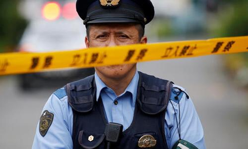 Cảnh sát Nhật Bản tại hiện trường một vụ án. Ảnh: Reuters.