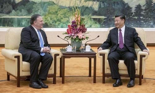 Chủ tịch Trung Quốc Tập Cận Bình (phải) và Ngoại trưởng Mỹ Mike Pompeo hội đàm hôm 14/6. Ảnh: Kyodo News.